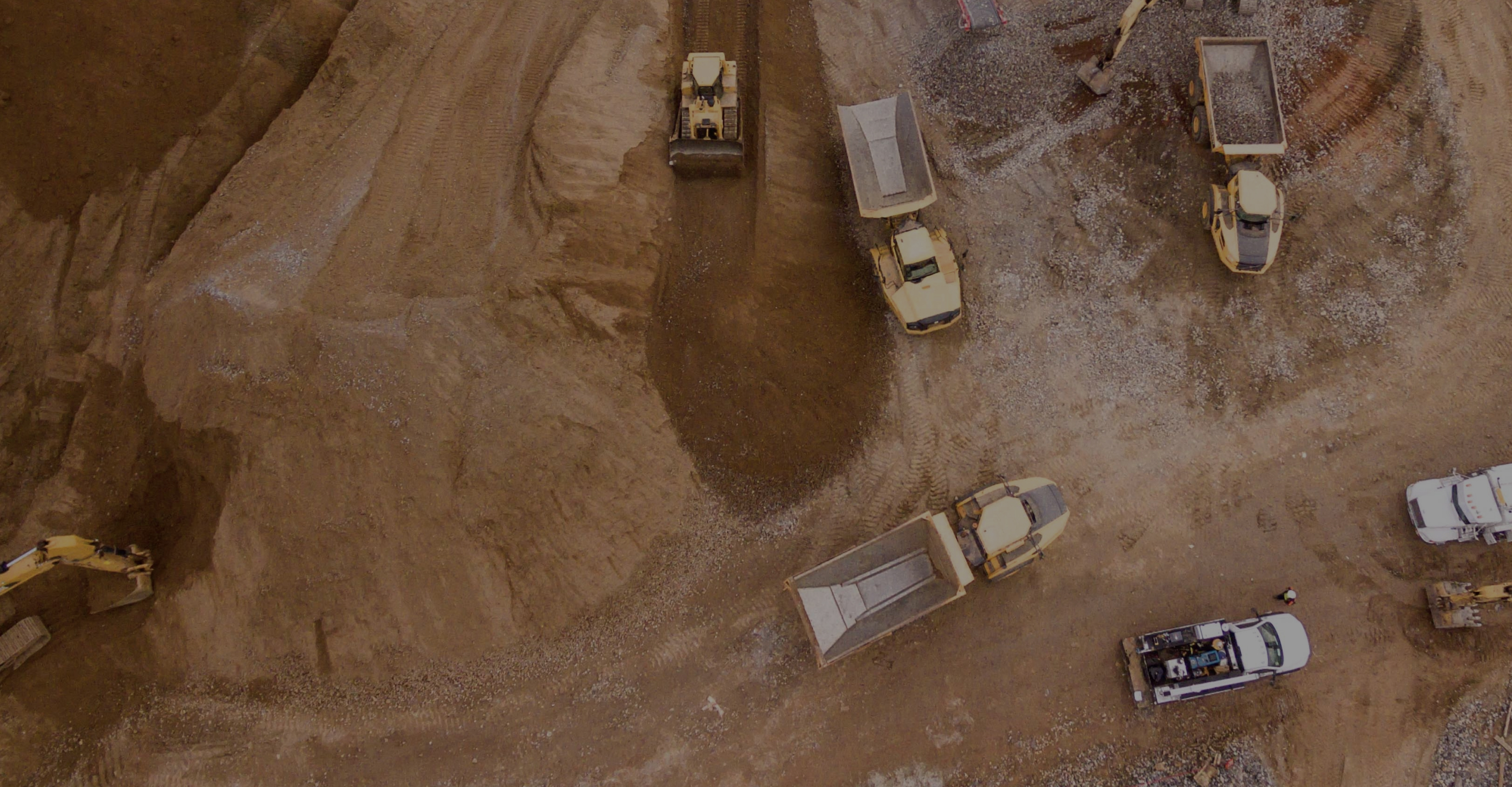 A top down photo of a mining site with mining equipment